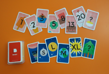 Sets of Boost planning poker cards laid out on a table.