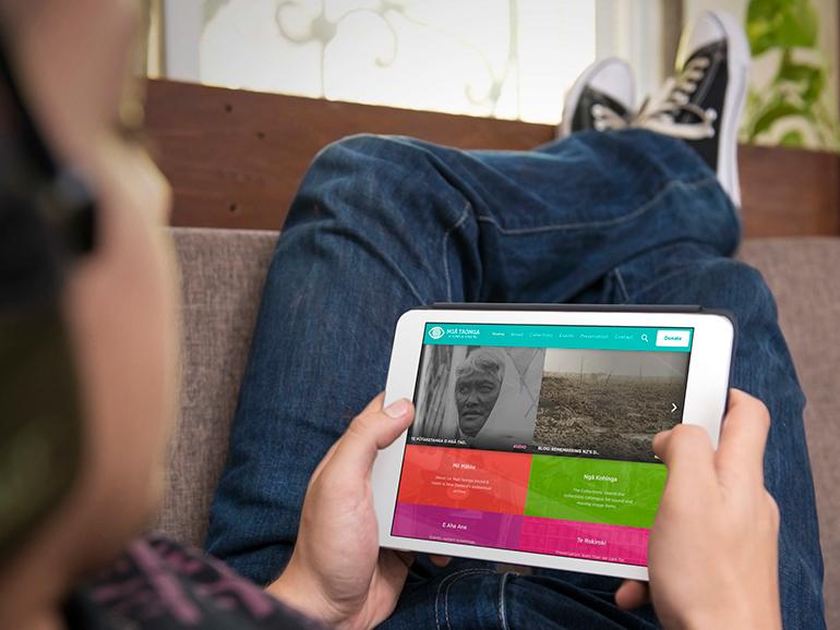 A school-kid uses Ngā Taonga on an iPad.