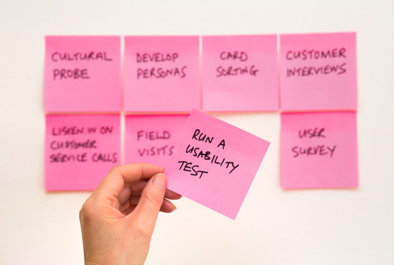 Addinga post-it to a collection of ways to research customers' needs.