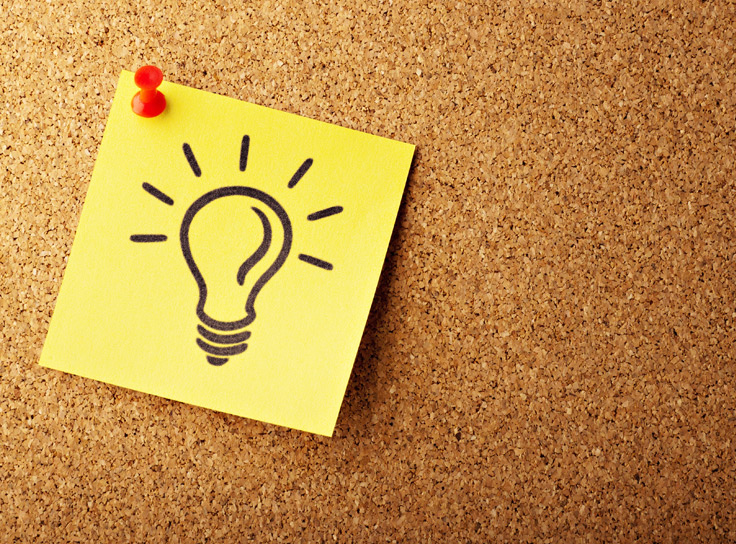 Picture of a lightbulb on a post-it. Product discovery starts with an idea.