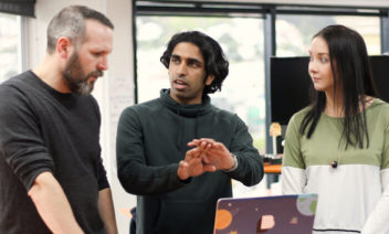 Discussing a software development project with two team members. The Extreme Programming customer is part of the project team.